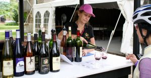 Terri Savaryn, Owner at Sovereign Estate pouring during the summer Waconia Wine Fest.